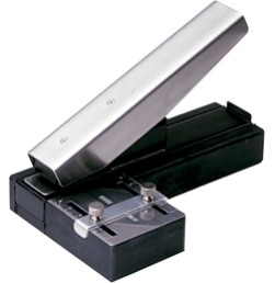 Stapler style slot punch with adjustable guide